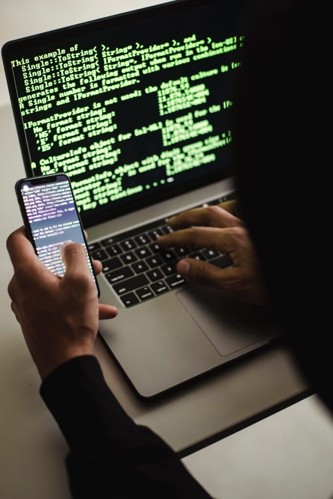 a hacker using laptop to hack phone - INTRO
