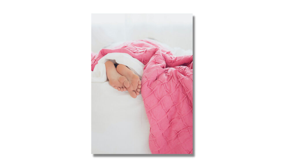 This picture depicts a Fake Sleep Person lying under blanket